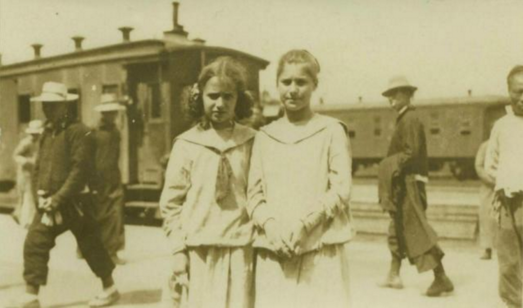 Slobodkina and her sister Tamara at the train station in Harbin en route to Vladivostok, May 1919.